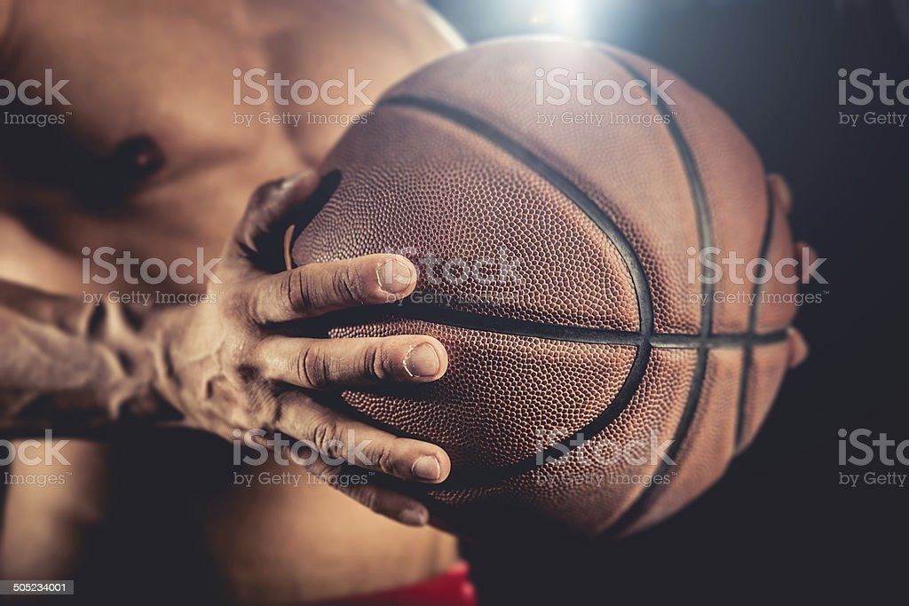 Basketball player holding a ball royalty-free stock photo