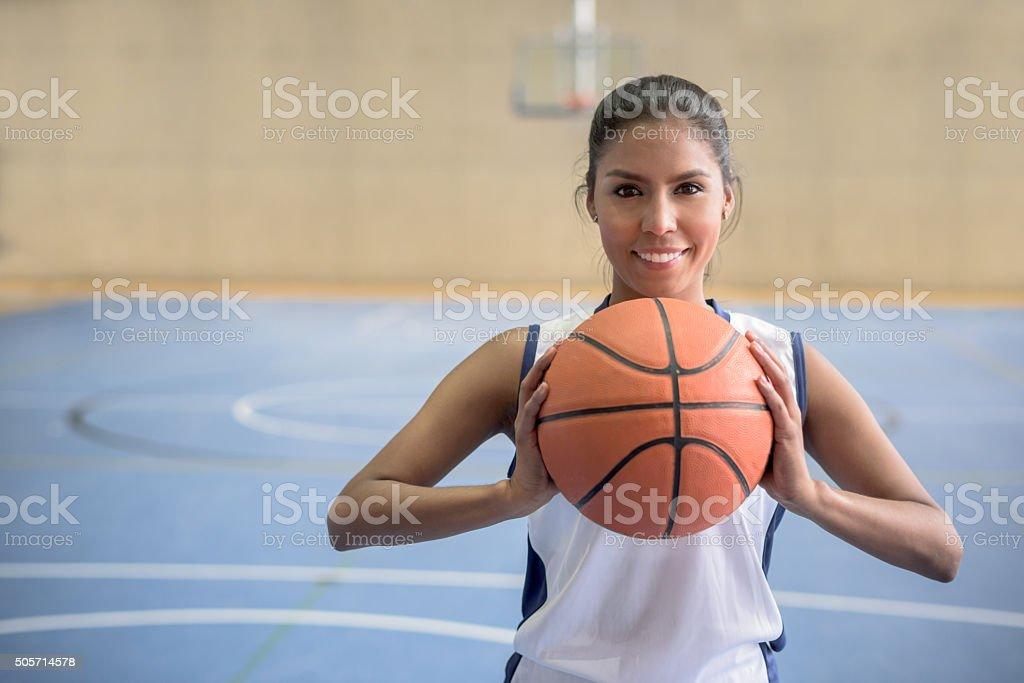 Basketball player holding a ball stock photo