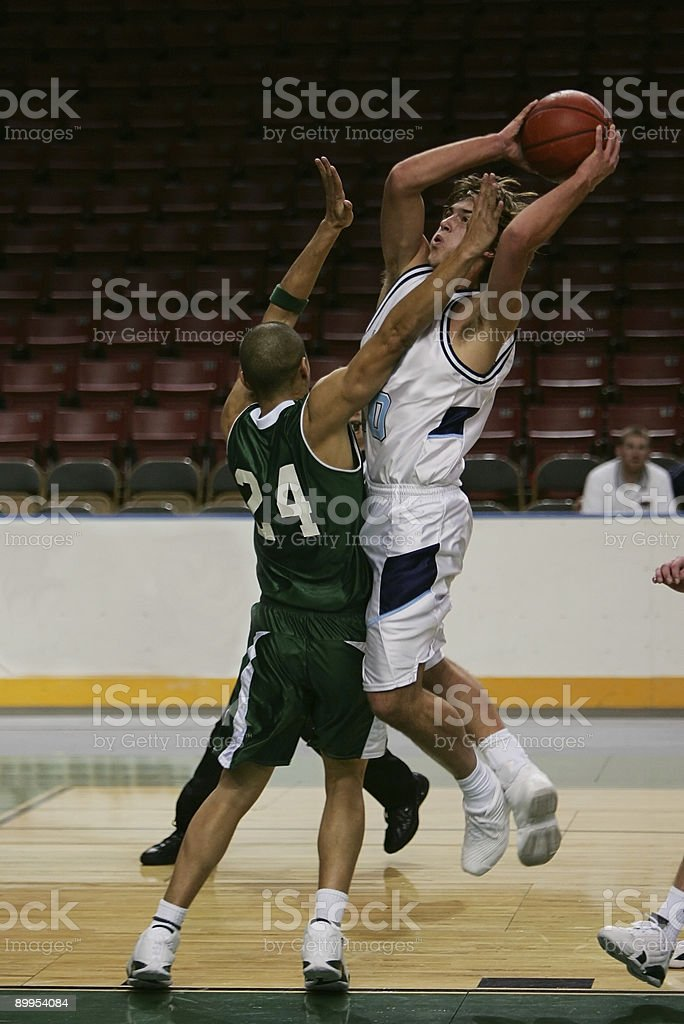 Basketball Player in Green Contests Driving Jump Shot stock photo