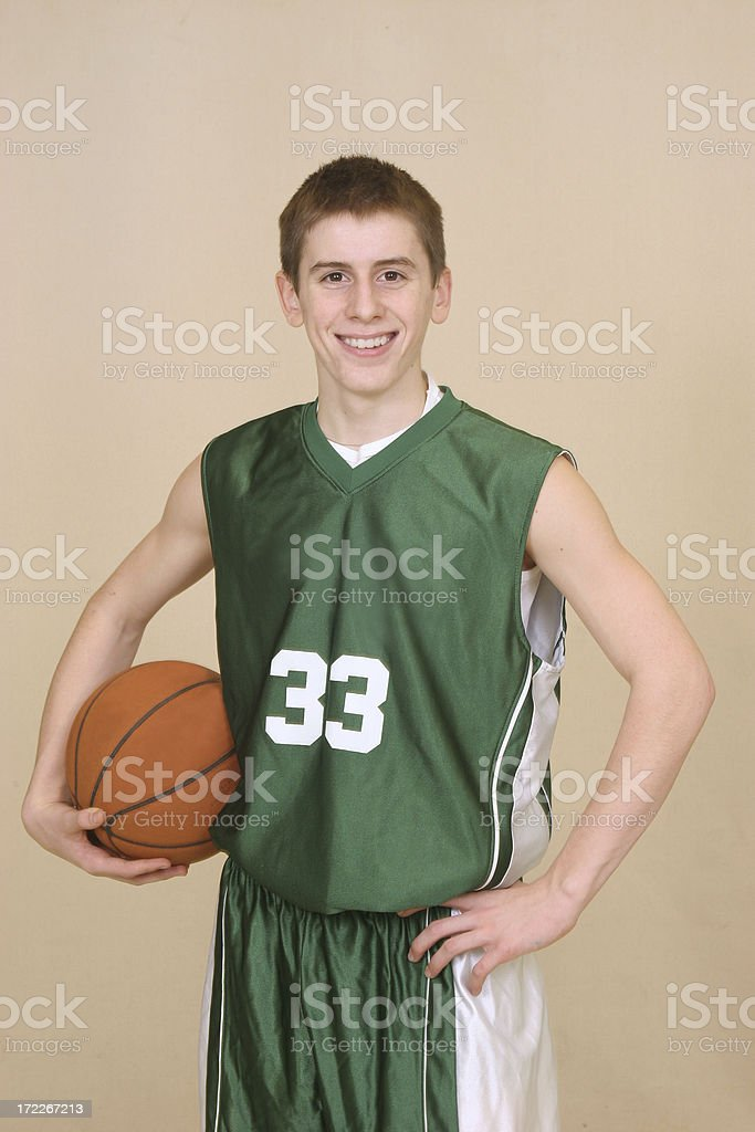 Basketball player in green uniform #33 royalty-free stock photo