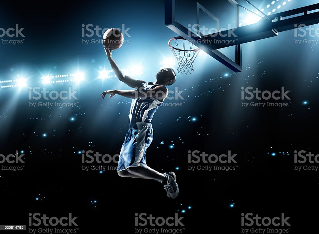 Basketball player in jump shot stock photo