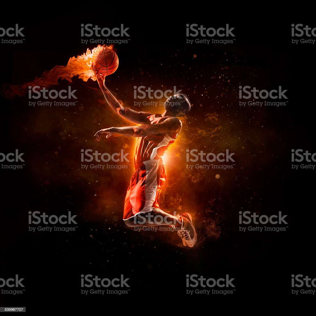 Basketball player in jump shot with fireball stock photo