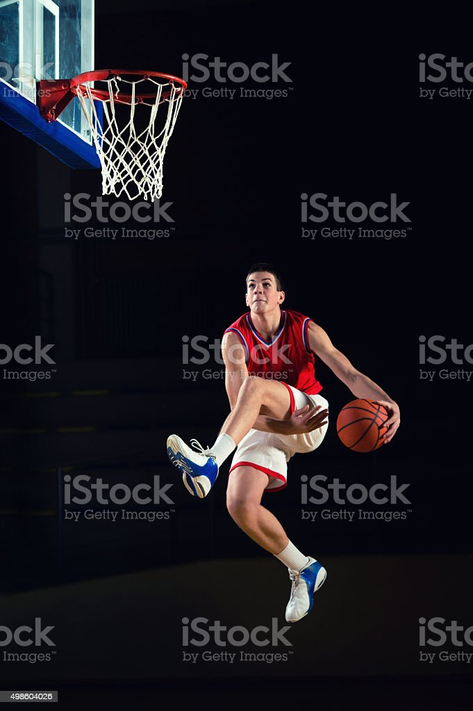 Basketball player jumping high towards the hop. stock photo