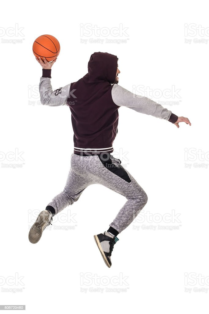 Basketball player jumping stock photo