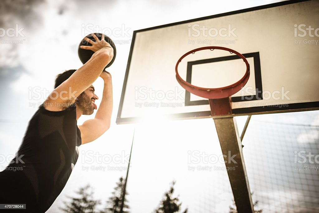 basketball player jumping to score stock photo