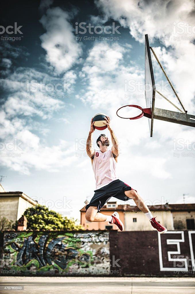 basketball player jumping to score stock photo