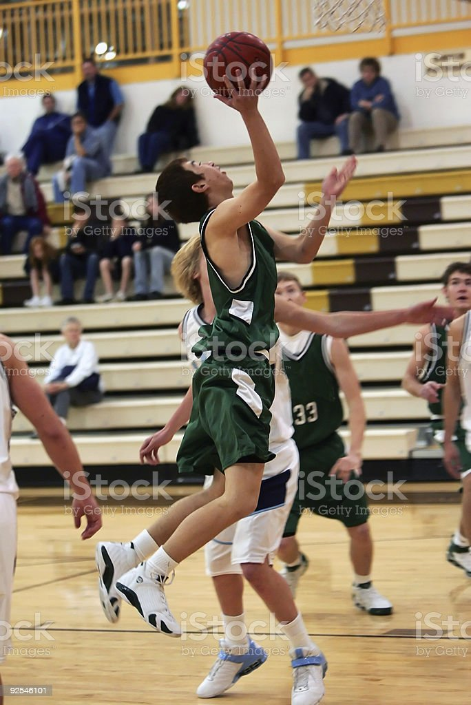 Basketball Player Jumps for Layup in the Lane stock photo