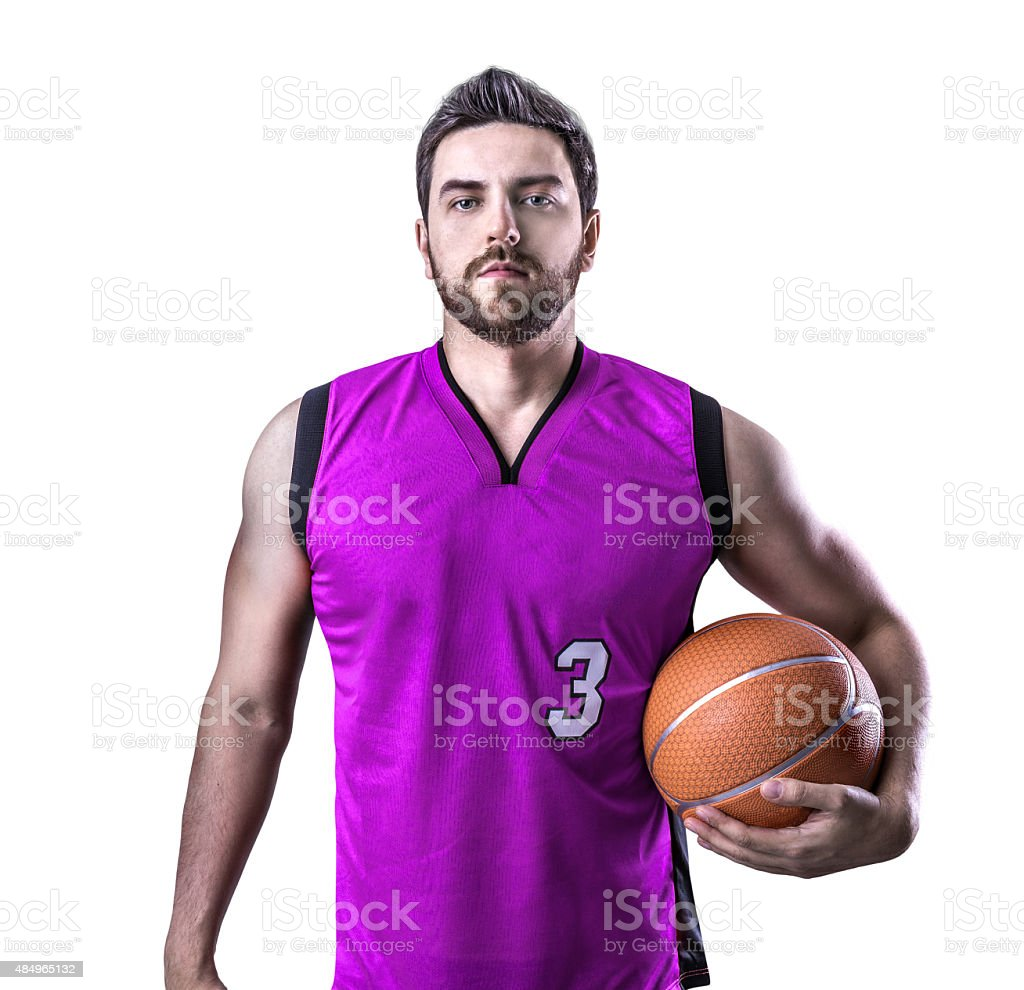 Basketball Player on a purple uniform isolated on white background stock photo