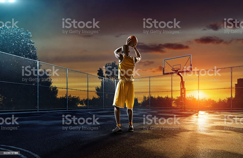 Basketball player on outdoor streetball playground stock photo