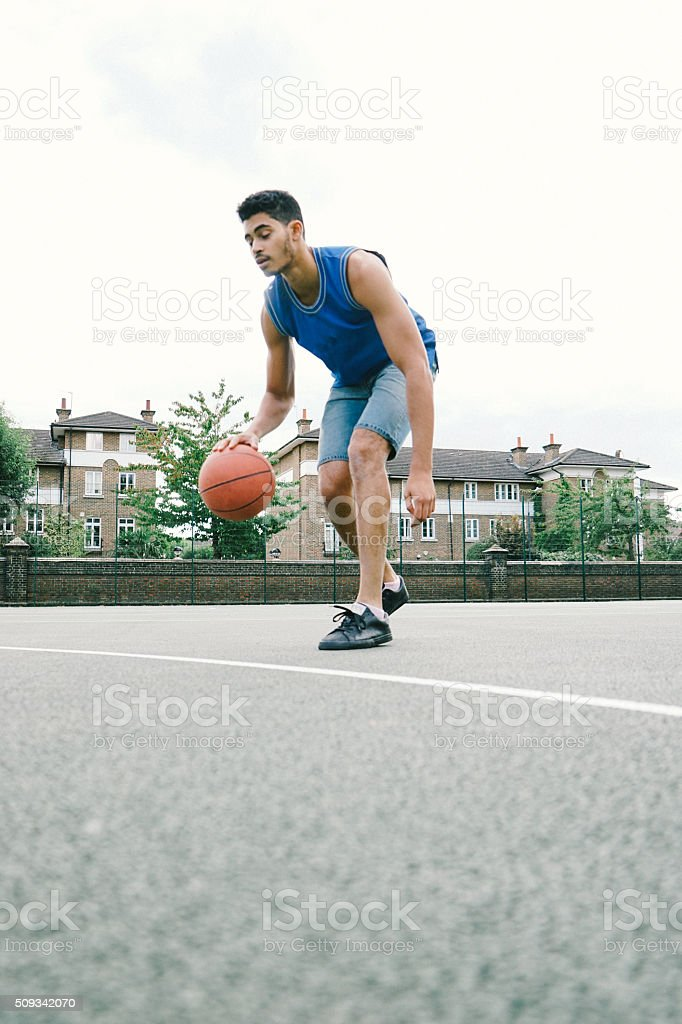 Basketball Player On The Court, Bouncing stock photo
