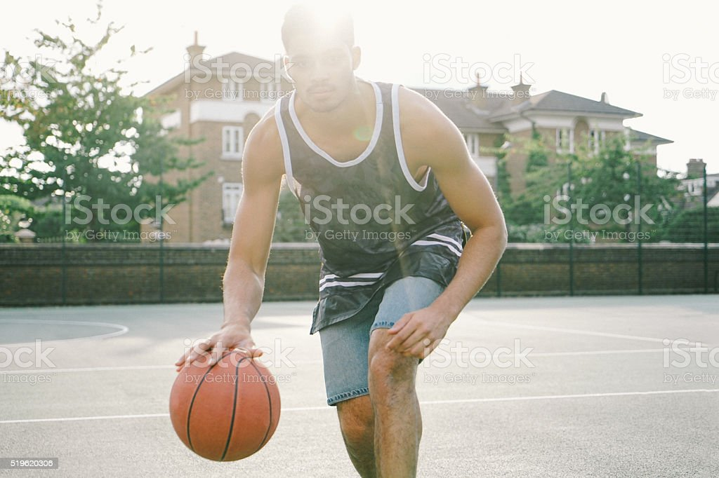 Basketball Player On The Court Facing Opponents stock photo