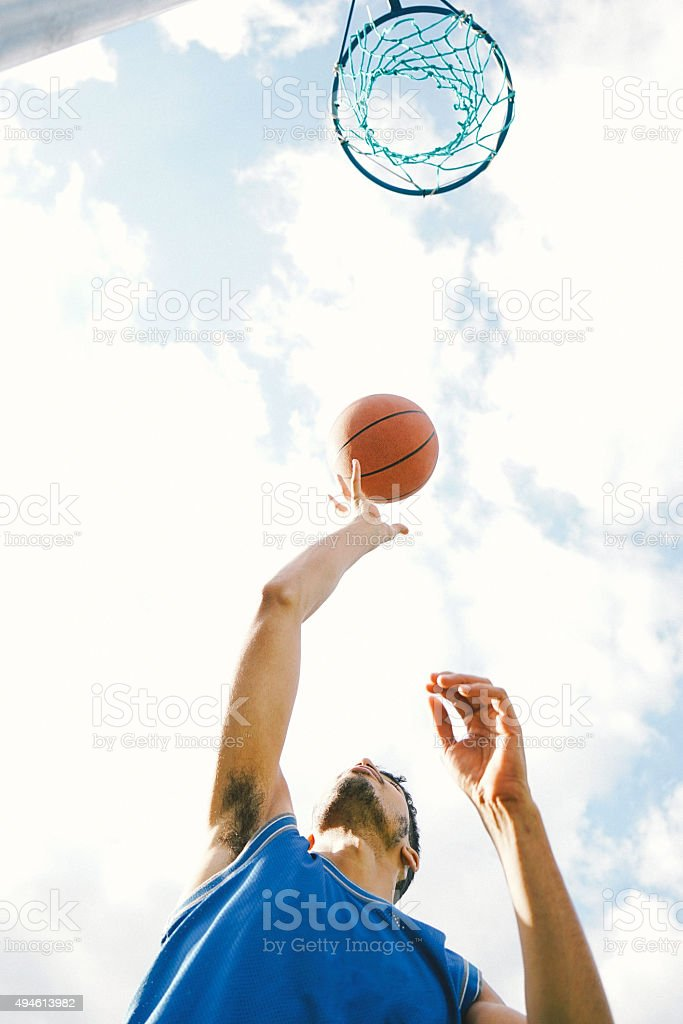 Basketball Player On The Court, Slam Dunking Ball stock photo