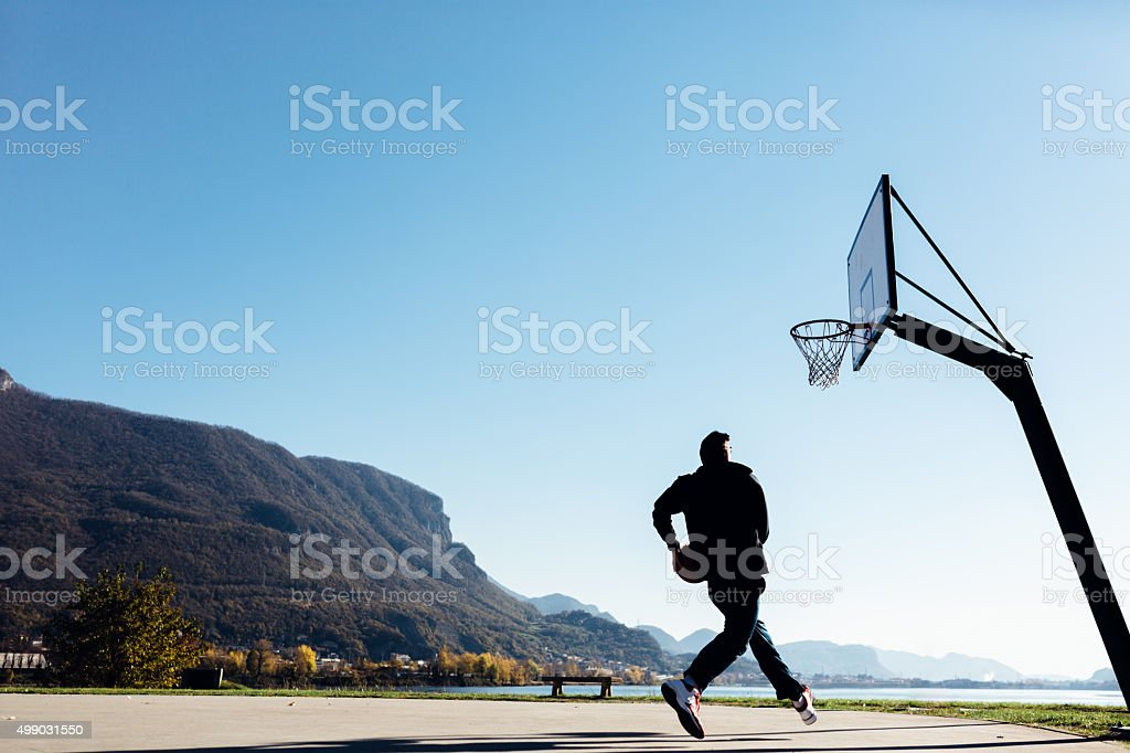 Basketball player on the outdoor court stock photo