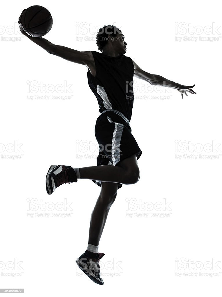 basketball player one hand slam dunk silhouette stock photo