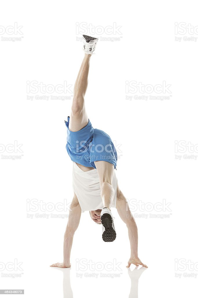 Basketball player performing handstand royalty-free stock photo
