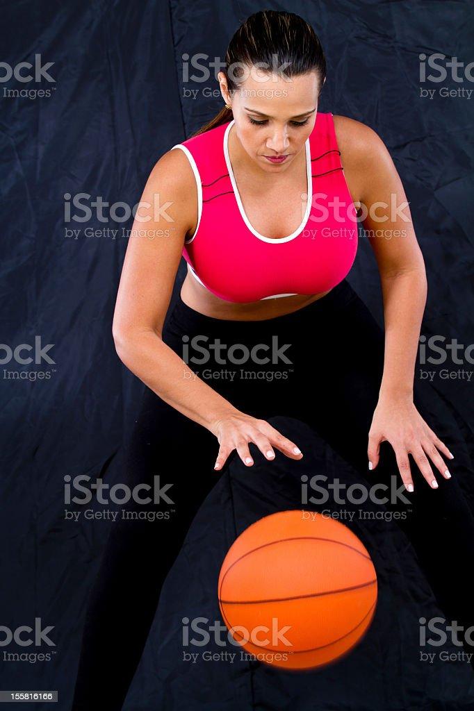 Female basketball player dribbling the ball