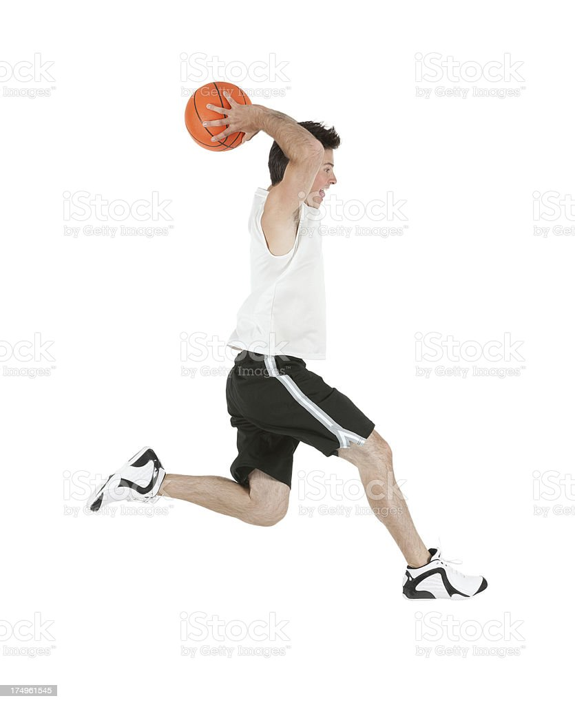 Basketball player playing with a ball royalty-free stock photo