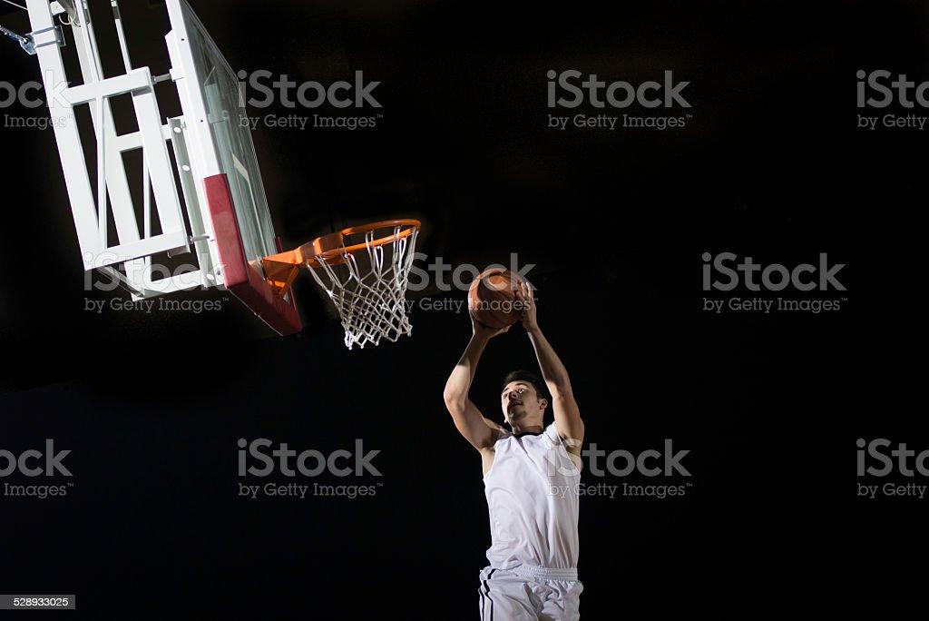 Basketball Player Scoring A Basket stock photo