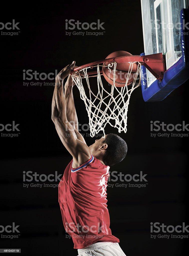 Basketball player slam dunking. stock photo