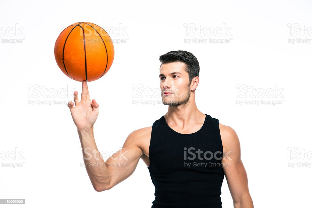 Basketball player spinning ball on his finger stock photo