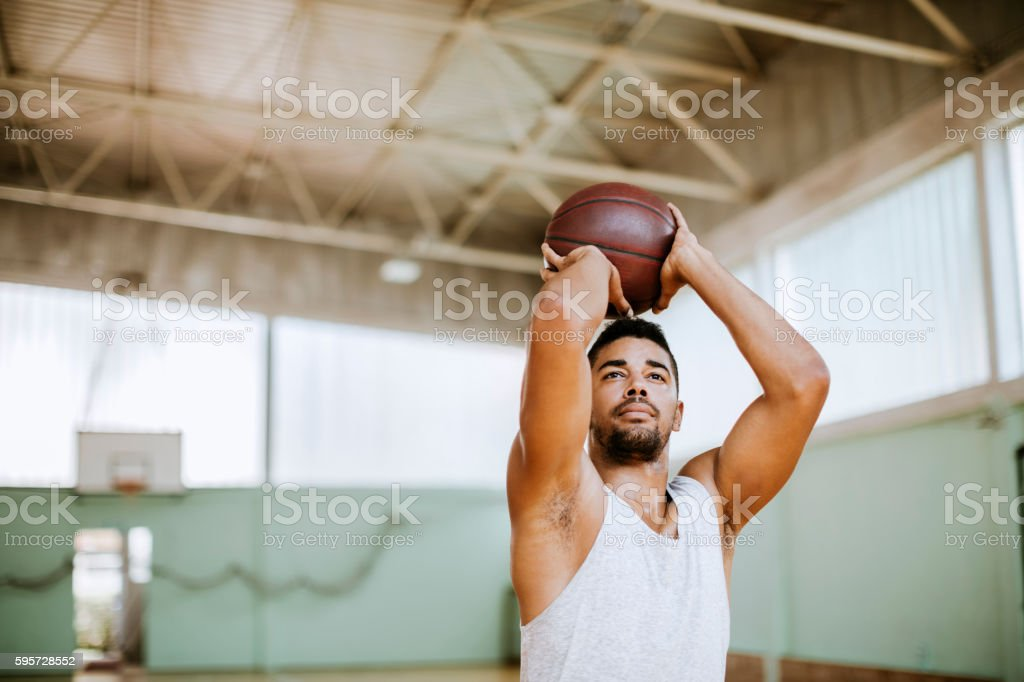 Basketball player taking a shot stock photo