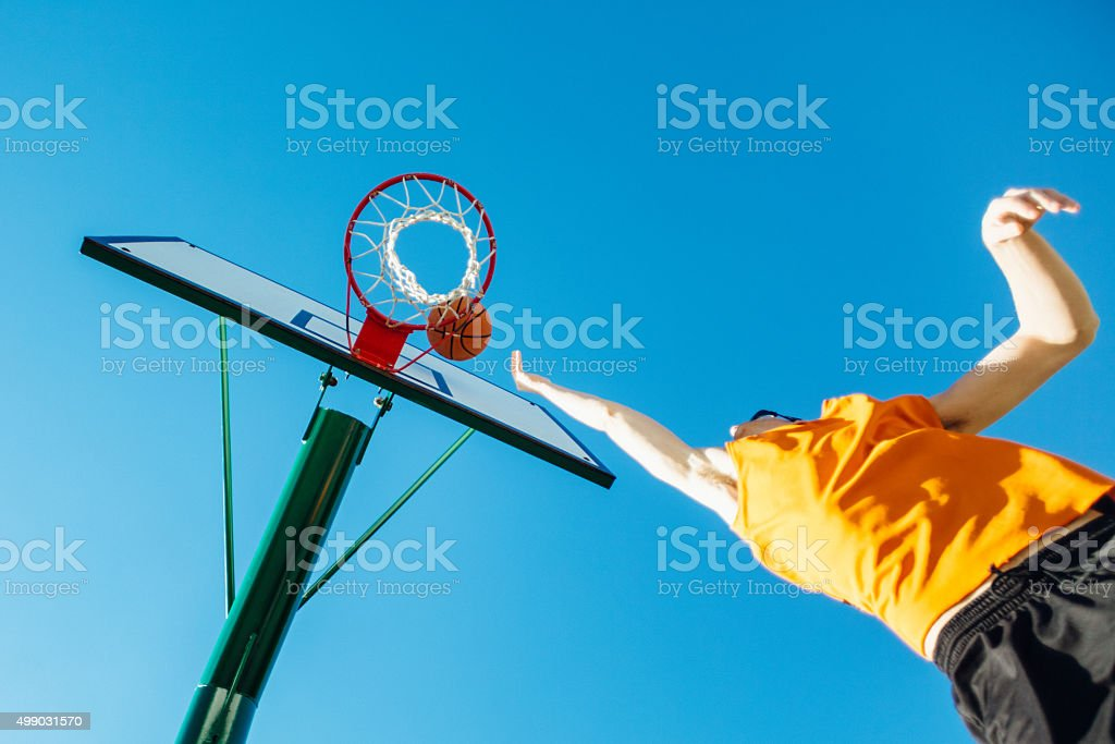 Basketball player to hoop stock photo