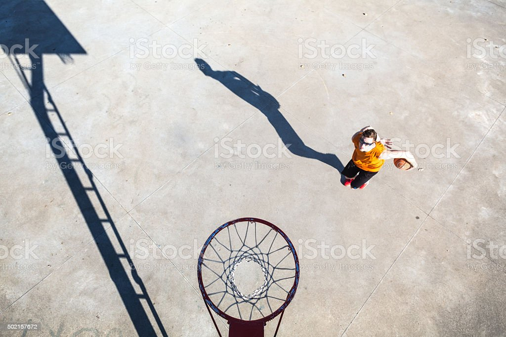 Basketball player under the basket stock photo