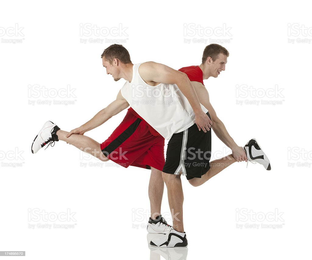Basketball players holding legs of each other stock photo