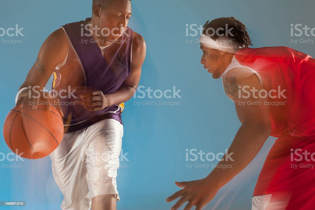 Basketball players playing basketball royalty-free stock photo