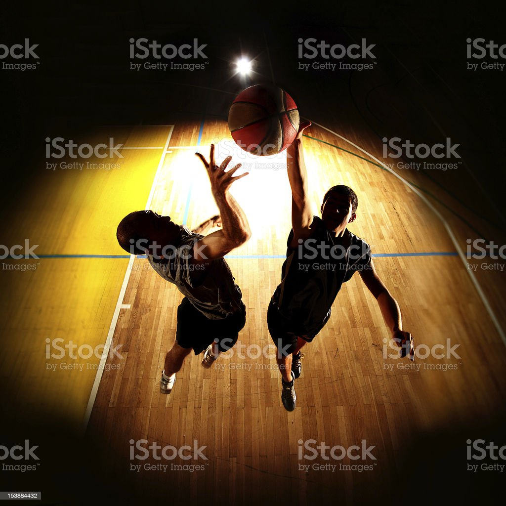 Basketball players with a round light ring throwing the ball stock photo