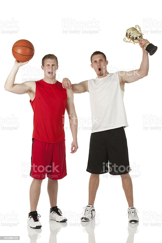 Basketball players with trophy royalty-free stock photo