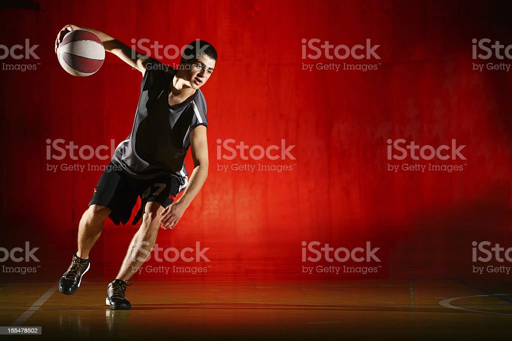 Basketball run on red background royalty-free stock photo