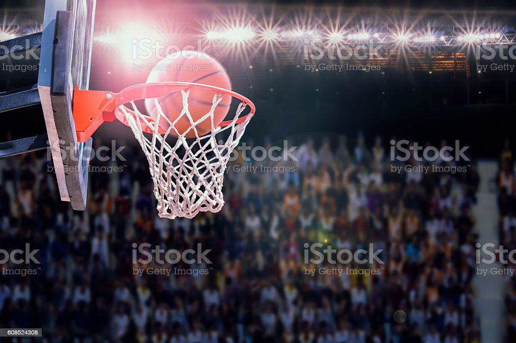 basketball scoring during match in arena stock photo