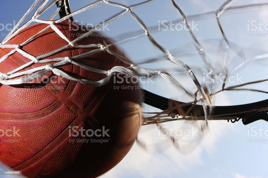 Basketball scoring points through the net stock photo