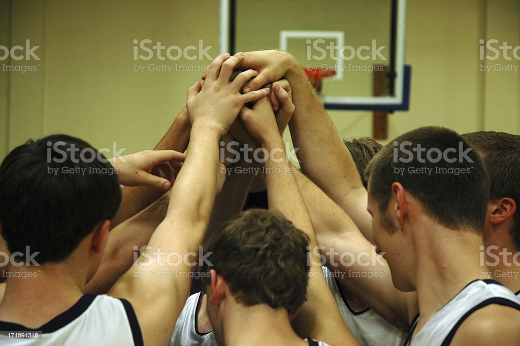 Basketball Team Just Before The Tip stock photo