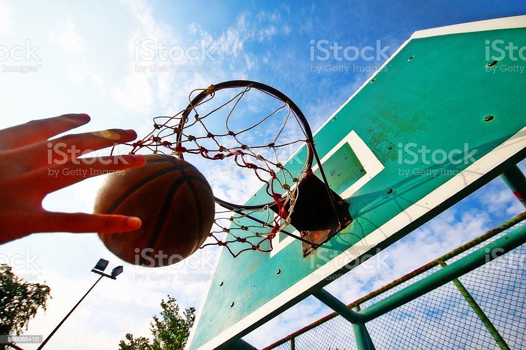 Basketball thrown in the hoop, scoring in game stock photo
