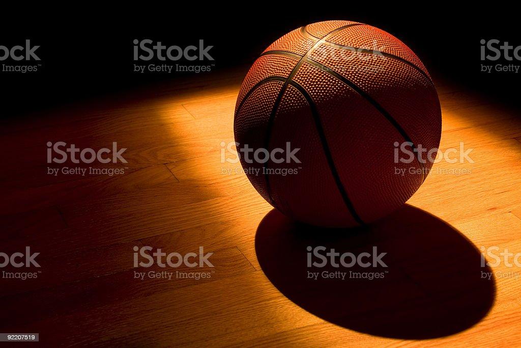 Basketball under the light stock photo