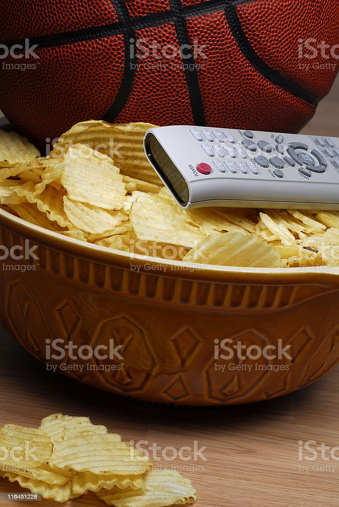 Basketball with chips and remote royalty-free stock photo