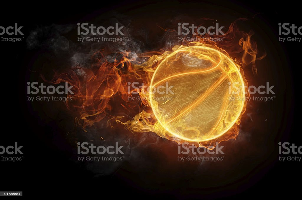 A basketball with flames on a black background stock photo