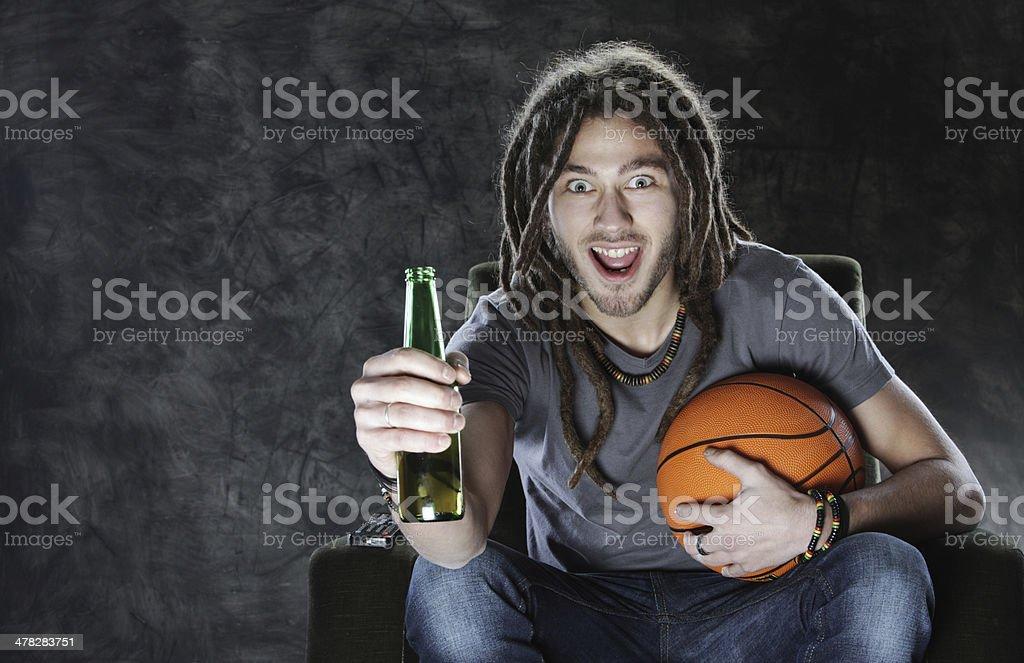 Basketballl fan watching television royalty-free stock photo