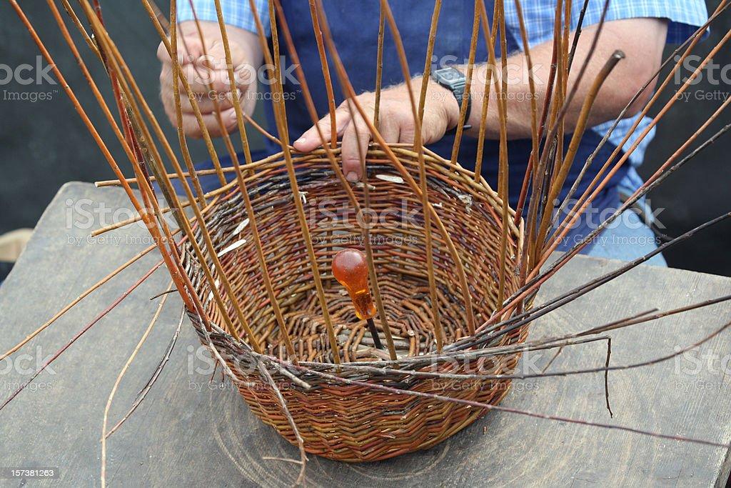 Basketmaker's hands in action stock photo