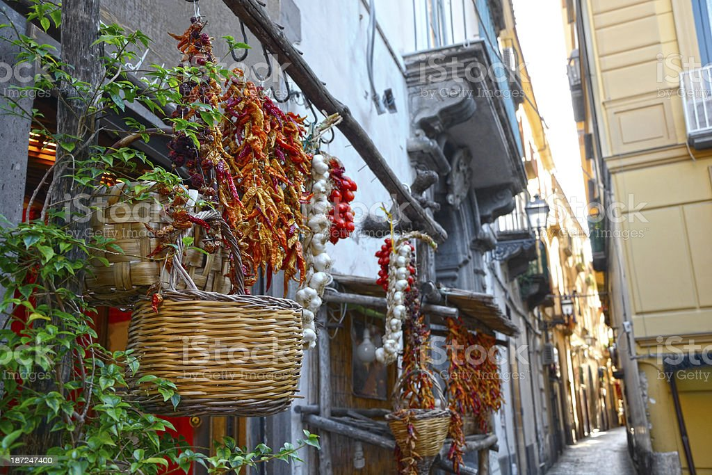 Baskets and plants hanging up outside on an Italian street stock photo