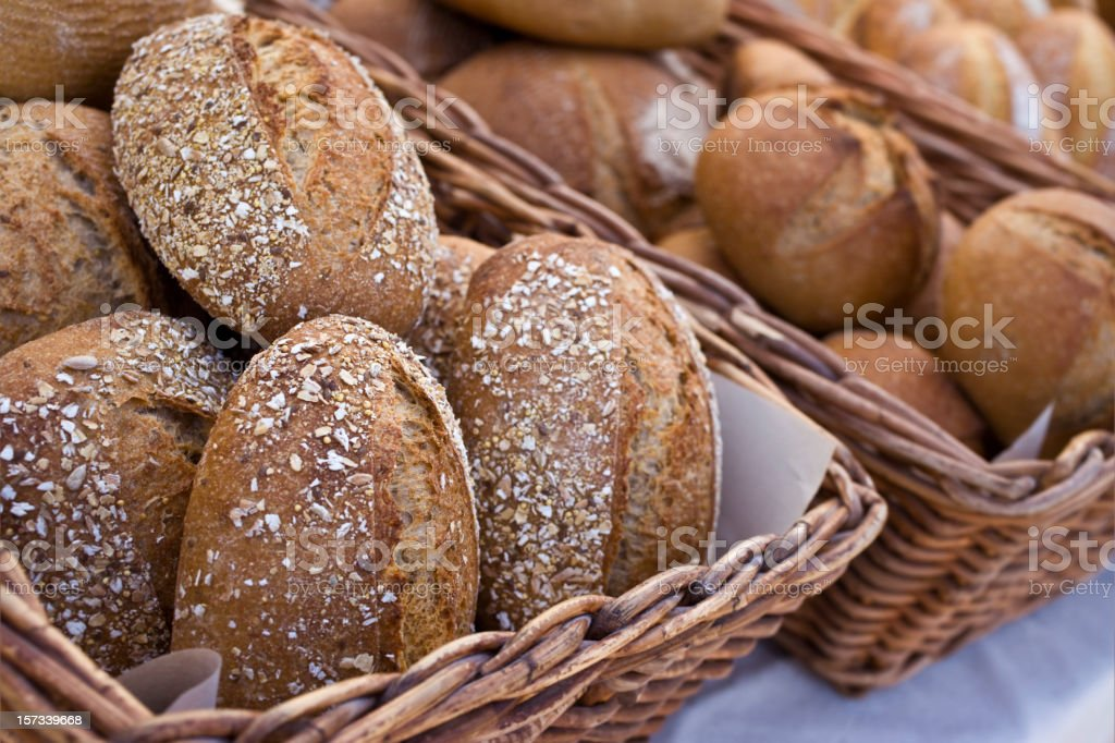 Baskets full of varieties of fresh bread arranged on a table royalty-free stock photo