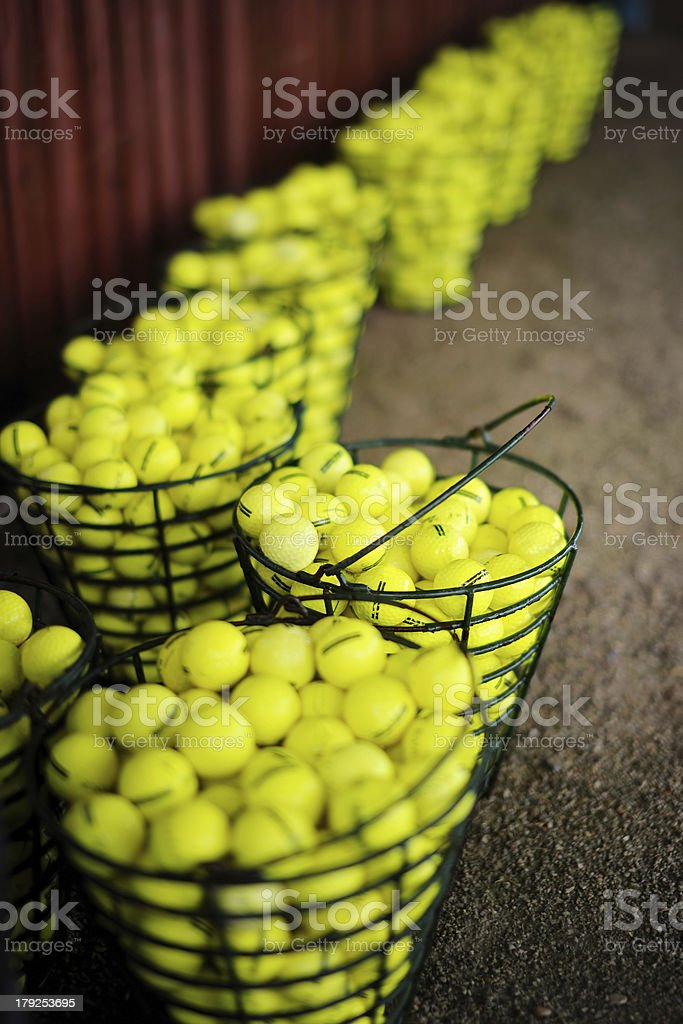 Baskets of golf balls on a field royalty-free stock photo