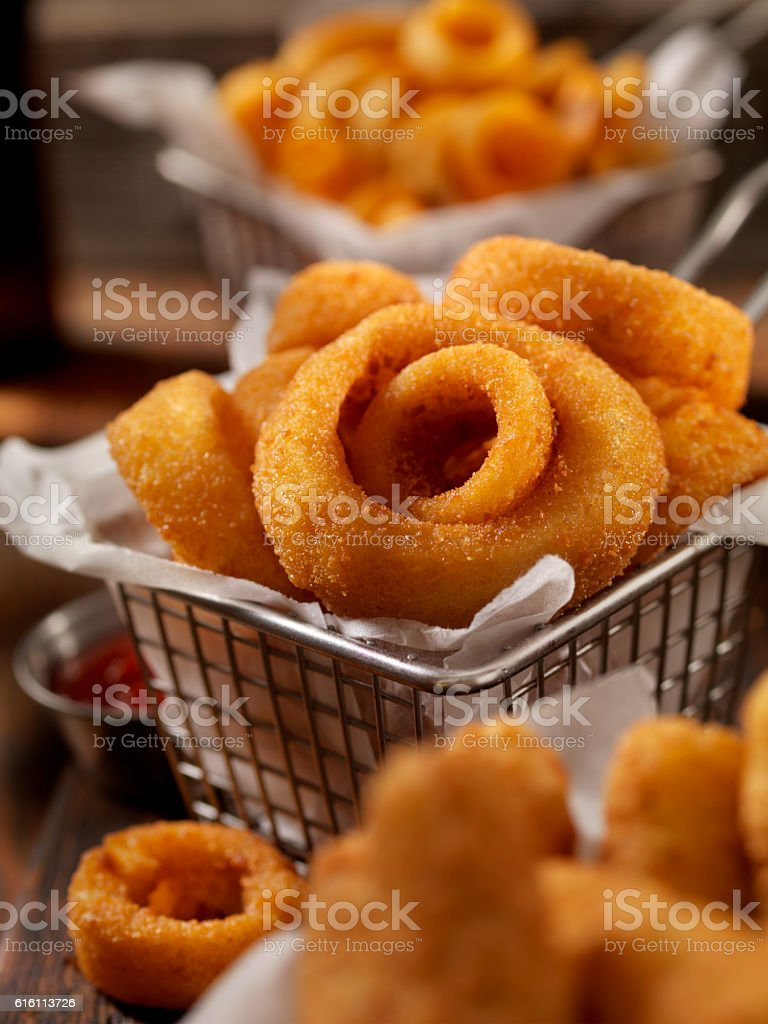 Baskets of Onion Rings, Curly Fries and Cheese Sticks stock photo