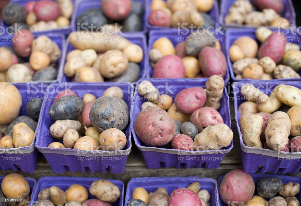 Baskets of potatoes at a Farmers Market royalty-free stock photo