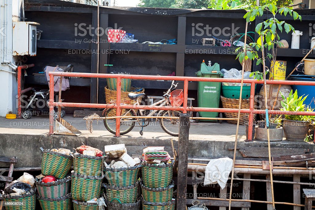 Baskets, waste and bicycle at canal stock photo