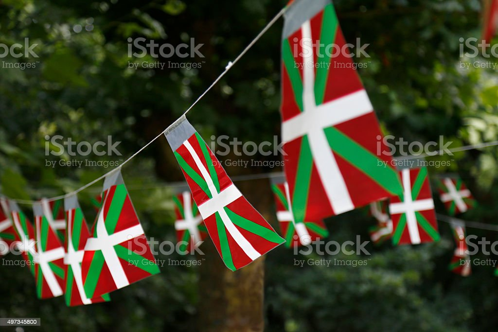 Basque country flags flying in a park with trees. stock photo