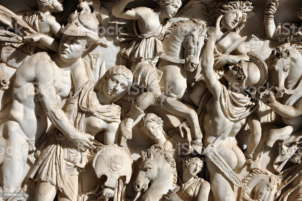 Bas-relief and sculpture of ancient Roman warriors stock photo