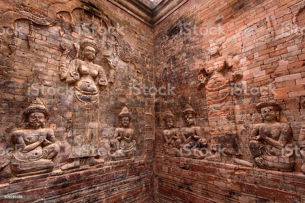 Bas-relief inside Prasat Kravan stock photo